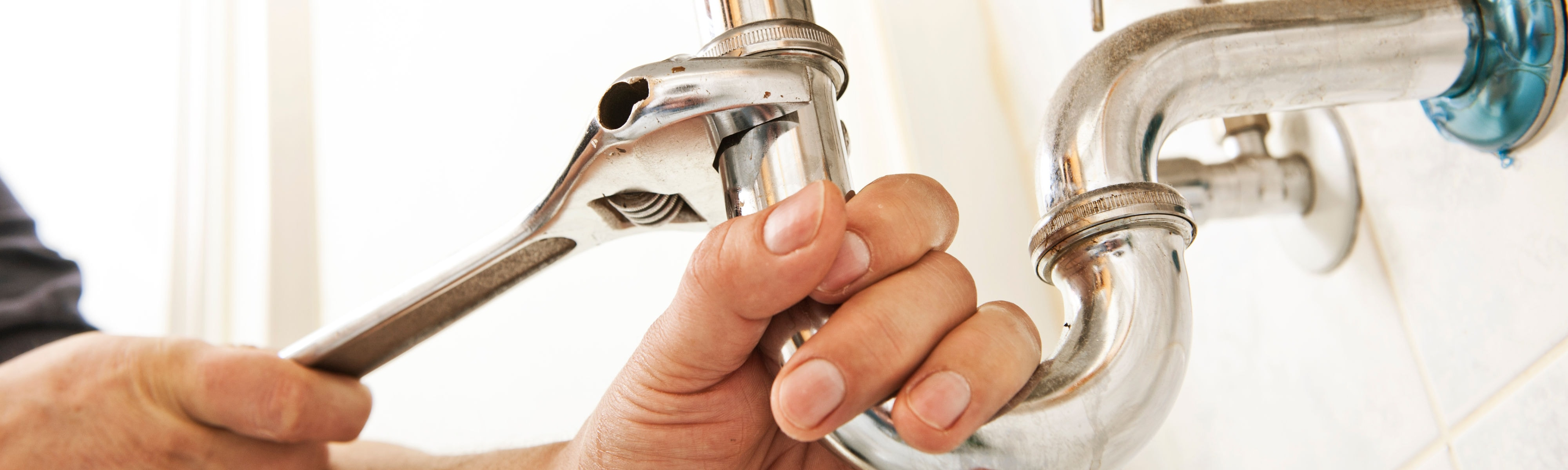 Plumber fixing a sink.