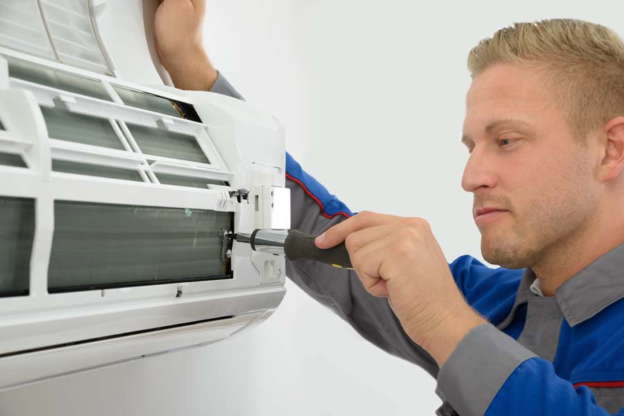 Technician Repairing Air Conditioner, Do I Really Need an AC Tune-Up?   HVAC, Install, Repair, IAQ   Vailes