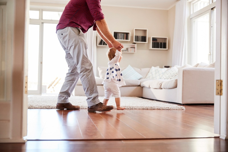 Father & child walking indoors, The Livable Design Concept | Home Remodeling | Vailes Home Services