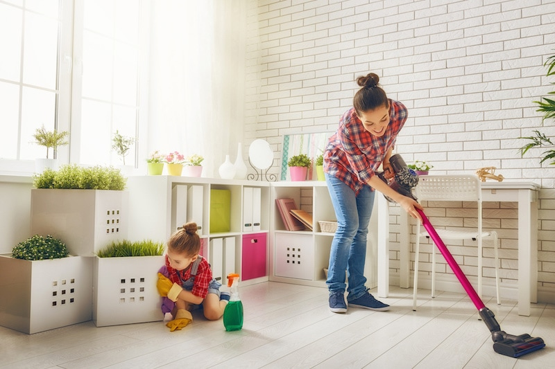 Woman cleaning with her daughter, Project Profile: Taylor High-Performance Home | HVAC Installation | Vailes