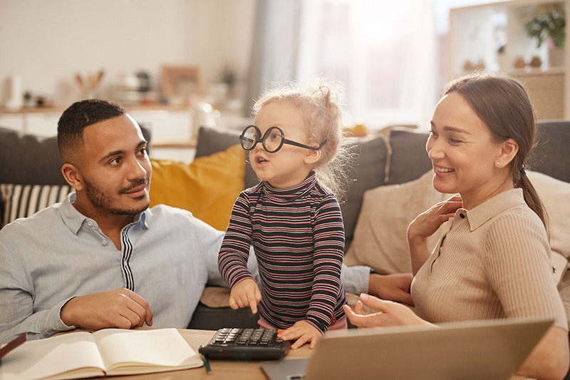 Family with young toddler indoors at a desk, MLZ Wins This Old House Best New Home Products Award!