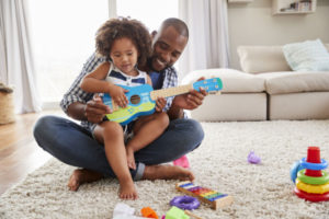 Dad and toddler play with toys in any season