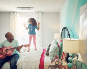 kid jumping on bed because they are going back to school